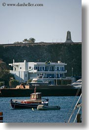 boats, buildings, europe, greece, harbor, monument, tinos, vertical, photograph