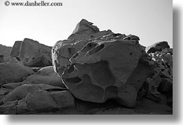 black and white, europe, greece, holes, horizontal, rocks, tinos, photograph