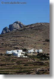 big, buildings, europe, greece, groups, hills, rocks, scenics, tinos, vertical, photograph