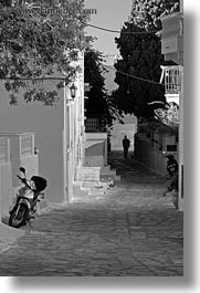black and white, europe, greece, men, motorcycles, silhouettes, streets, tinos, towns, vertical, photograph