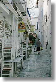 chairs, europe, greece, stacked, tinos, towns, vertical, walking, womens, photograph