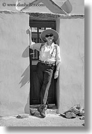 black and white, carol, clothes, doors, emotions, europe, greece, happy, hats, people, senior citizen, smiles, sunglasses, tourists, vertical, womens, photograph