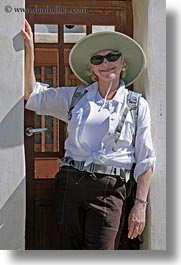 carol, clothes, doors, emotions, europe, greece, happy, hats, people, senior citizen, smiles, sunglasses, tourists, vertical, womens, photograph