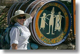 barrels, carol, clothes, emotions, europe, greece, happy, hats, horizontal, people, senior citizen, signs, smiles, sunglasses, tourists, womens, photograph