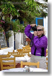 artists, blonds, cameras, carol, clothes, europe, greece, people, photographers, picture, sunglasses, taking, tourists, vertical, womens, photograph