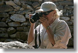 artists, blonds, cameras, carol, clothes, emotions, europe, greece, happy, hats, horizontal, people, photographers, senior citizen, smiles, sunglasses, tourists, womens, photograph