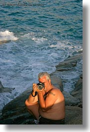 artists, cameras, emotions, europe, greece, kostas, men, ocean, people, photographers, photographing, smiles, sun, tourists, vertical, photograph