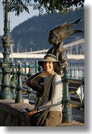 brunette, clothes, emotions, europe, groups, hair, hats, hungary, lori, people, princess, smiles, statues, vertical, womens, photograph