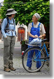 bicycles, brunette, clothes, emotions, europe, groups, hair, hats, hungary, lori, men, old, people, smiles, talking, vertical, womens, photograph