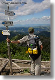 backpack, baseball cap, clothes, clouds, directional, europe, groups, hats, hikers, hungary, landscapes, looking, men, nature, over, people, ron seely, signs, sky, tour guides, vertical, photograph