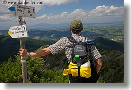 backpack, baseball cap, clothes, clouds, directional, europe, groups, hats, hikers, horizontal, hungary, landscapes, looking, men, nature, over, people, ron seely, signs, sky, tour guides, photograph