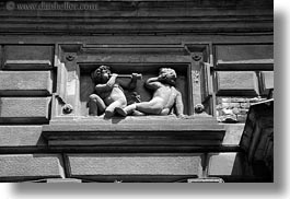 arts, black and white, blowing, budapest, cherub, europe, horizontal, horns, hungary, relief, stones, photograph