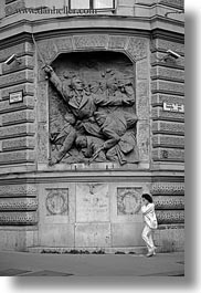 arts, black and white, budapest, cell phone, communist, europe, hungary, relief, vertical, walking, womens, photograph