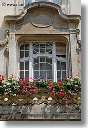 budapest, buildings, europe, flowers, hungary, ornate, vertical, windows, photograph