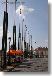 budapest, castle hill, europe, flags, hungary, poles, streets, vertical, photograph