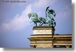 arts, bronze, budapest, chariots, clouds, europe, heroes square, horizontal, hungary, landmarks, materials, monument, nature, sky, transportation, photograph