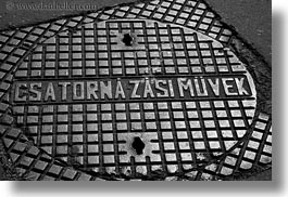 black and white, budapest, covers, europe, horizontal, hungary, irons, manhole covers, manholes, materials, photograph
