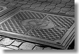 black and white, budapest, cobblestones, covers, europe, horizontal, hungary, irons, manhole covers, manholes, materials, photograph