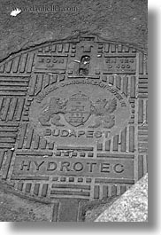 black and white, budapest, covers, europe, hungary, irons, manhole covers, manholes, materials, vertical, photograph