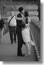 black and white, bridge, budapest, conceptual, couples, emotions, europe, hungary, kissing, men, people, romantic, vertical, womens, photograph
