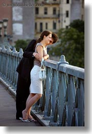budapest, conceptual, couples, emotions, europe, hungary, looking, men, over, people, railing, romantic, smiles, vertical, womens, photograph