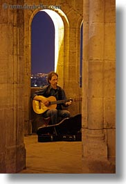 archways, artists, budapest, europe, guitars, hungary, instruments, men, music, musicians, nite, people, players, slow exposure, vertical, windows, photograph