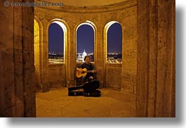 archways, artists, budapest, europe, guitars, horizontal, hungary, instruments, men, music, musicians, nite, people, players, slow exposure, windows, photograph