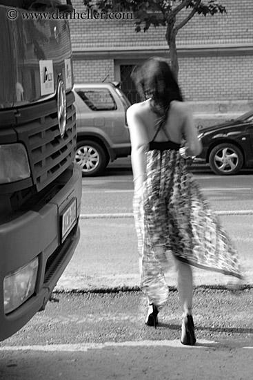 woman-walking-by-bus-bw-1.jpg