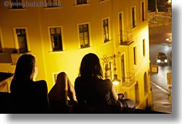 budapest, cars, colors, europe, horizontal, hungary, nite, people, silhouettes, watching, womens, yellow, photograph