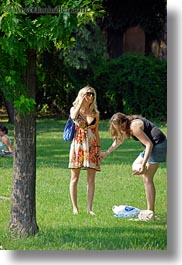 blonds, breasts, budapest, clothes, colors, europe, green, hair, hungary, park, people, sunglasses, vertical, womens, photograph