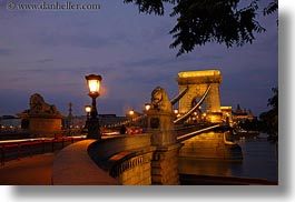 bridge, budapest, europe, heads, horizontal, hungary, lamp posts, lions, nite, slow exposure, statues, structures, szechenyi chain bridge, photograph