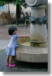 asian, childrens, emotions, europe, fountains, girls, hands, hungary, little, people, smiles, tarcal, vertical, washing, water, photograph