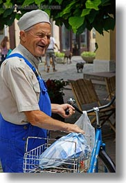 bicycles, clothes, emotions, europe, hats, hungary, men, old, people, smiles, smiling, tarcal, vertical, photograph