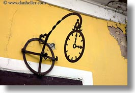 clocks, europe, horizontal, hungary, irons, signs, tarcal, walls, photograph