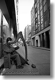 capital, cities, dublin, eastern ireland, europe, harpist, ireland, irish, leinster, streets, vertical, photograph