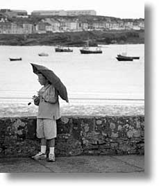 black and white, cork county, europe, ireland, irish, kid, loop head, loophead penninsula, munster, umbrellas, vertical, photograph