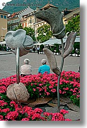 bolzano, dolomites, europe, flowers, italy, people, sculptures, vertical, photograph