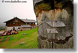 alto adige, carvings, dolomites, europe, horizontal, houses, italy, stumps, trees, photograph
