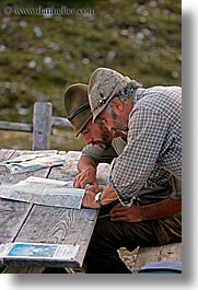 alto adige, dolomites, europe, italy, ladin, map, men, people, reading, vertical, photograph