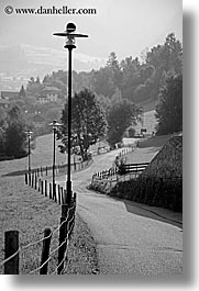 alto adige, black and white, dolomites, europe, fences, italy, lamp posts, roads, rosengarten, valley, vertical, photograph