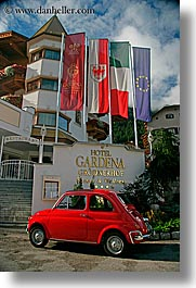 alto adige, cars, dolomites, europe, gardena, hotels, italy, red, st ulrich, vertical, photograph