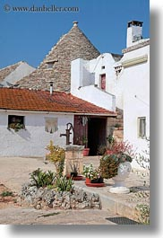 alberobello, buildings, europe, farm house, houses, italy, puglia, structures, trullis, vertical, wash, white, photograph