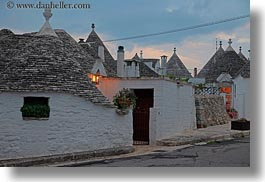 alberobello, buildings, dusk, europe, horizontal, italy, lamps, puglia, structures, trullis, photograph