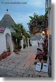 alberobello, buildings, europe, flowers, italy, puglia, structures, trullis, vertical, photograph