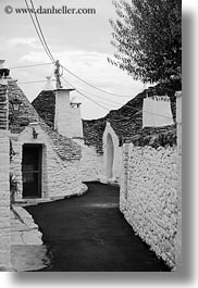 alberobello, black and white, buildings, europe, italy, puglia, structures, trullis, vertical, wash, white, photograph