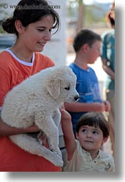alberobello, childrens, europe, italy, people, petting, puglia, puppies, vertical, white, photograph