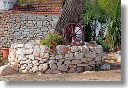 alberobello, europe, flowers, horizontal, italy, plants, puglia, trees, wagons, wheels, photograph