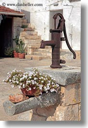 alberobello, europe, flowers, italy, materials, metal, plants, puglia, pumps, rust, vertical, water, photograph