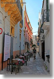 alleys, europe, gallipoli, italy, narrow, puglia, restaurants, tables, vertical, photograph