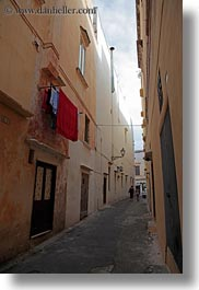 europe, gallipoli, italy, laundry, puglia, red, vertical, photograph